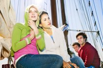 Friends on a sailing ship looking aside — Stock Photo