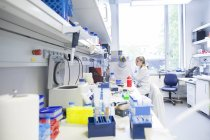 Young female scientist working at biological laboratory — Stock Photo
