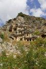 Turkey, Lycia, Lycian Coast, Myra, Lycian Rock Tombs against clouds — Stock Photo