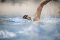Close up of Crawler swimming in indoor swimming pool — Stock Photo