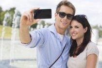 Couple making selfie smiling at camera — Stock Photo