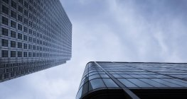 Extreme worms eye view of facades at financial district, Docklands, London, UK — Stock Photo