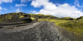 Iceland, Sudurland, Landmannalauger, Street through volcanic highland — Stock Photo