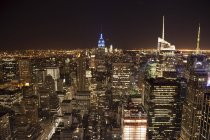 USA, New York, illuminated skyline at night — Stock Photo