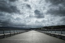 Cloudscape over wooden pier in Bangor, Wales, Great Britain — Stock Photo