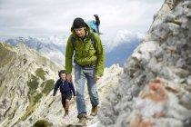Austria, Tyrol, Karwendel mountains, Mountaineers hiking in Alps — Stock Photo