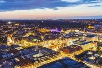 Germania, Sassonia, Leipzig, illuminato centro città al crepuscolo — Foto stock