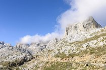 Spain, Cantabria, Picos de Europa National Park, Hiking area Los Urrieles and clouds — Stock Photo