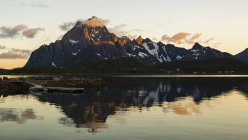 Norway, Lofoten Island, rocky mountains and reflection in water — Stock Photo