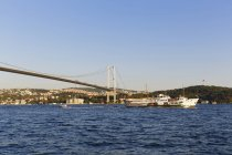 Bosphorus Bridge, ferry boat by Bosporus and the Beylerbeyi Palace, view from Ortaky, Istanbul, Turkey — Stock Photo