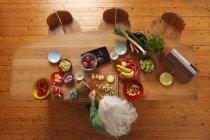 Overhead view of Senior woman preparing raw food — Stock Photo