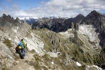 Austria, Tyrol, Karwendel mountains, Mountaineer in Alps — Stock Photo