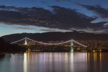 Canada, Vancouver, Lions Gate Bridge illuminated at night — Stock Photo
