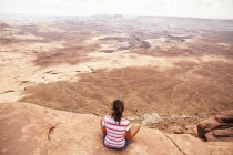 USA, UTah, Young woman looking over Canyonlands National Park — Stock Photo
