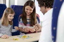Happy family playing in a train — Stock Photo