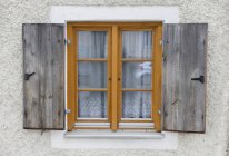 Window with old shutters — Stock Photo