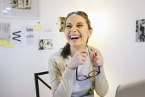 Laughing woman at modern home office — Stock Photo