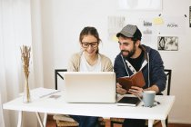 Young couple working at modern home office — Stock Photo
