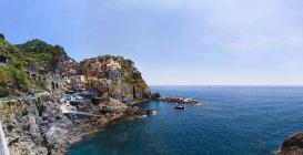 Italia, Cinque Terre, La Spezia, Liguria, Riomaggiore, Manarola, costa e case — Foto stock