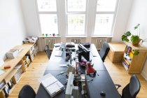 Interior view of workspace in modern empty office — Stock Photo