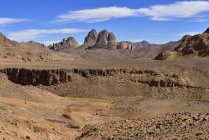 Algeria, View of volcanic landscape, Hoggar Mountains in background — Stock Photo
