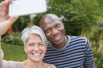 Portrait of smiling couple taking selfie with smartphone — Stock Photo
