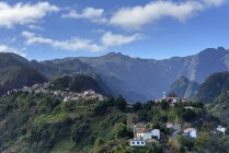 Portugal, Madeira, mountain village near Santana and rocks on background — Stock Photo