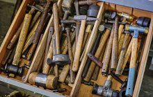 Various hammers at box in a workshop — Stock Photo
