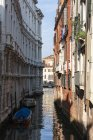 Italy, Veneto, Venice, Boats on canal and old traditional buildings — Stock Photo