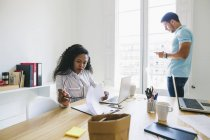 Young businessman and woman working together in office — Stock Photo