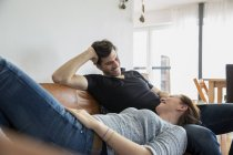 Affectionate couple relaxing at home on sofa — Stock Photo