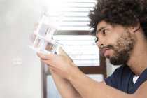 Young man examining architectural model — Stock Photo