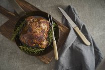 Leg of lamb with rosemary, frying pan — Stock Photo