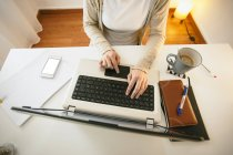 Woman using laptop at modern home office — Stock Photo