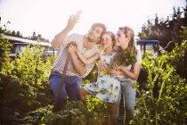 Family taking selfie in vegetable garden together — Stock Photo