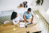 Young businessman and woman working in office with laptop — Stock Photo
