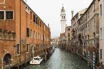 Italy, Veneto, Venice, boats on canal against buildings — Stock Photo