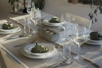 Festive laid table with individual table decoration — Stock Photo