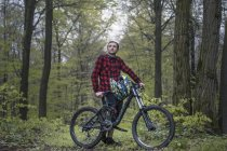Bike Freeride in forest, Young man with moutain bike — Stock Photo