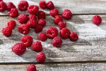 Fresh ripe Raspberries on rustic wooden table — Stock Photo