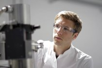 Portrait of scientist working at spectrometer in analytical laboratory — Stock Photo