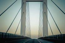 Germany, Mecklenburg-Western Pomerania, Ruegen bridge at sunrise — Stock Photo