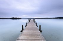 Austria, View of Worthersee Lake with wood pier — Stock Photo