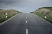 Germany, Ingolstadt, empty country road with cloudy sky — Stock Photo