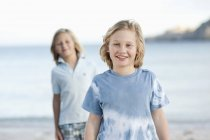 Boy smiling at camera on beach — Stock Photo