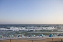 Row of sunshades on coast, Egypt — Stock Photo
