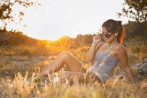 Teenage girl lying on meadow with head phones — Stock Photo