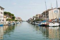 Italy, Friuli, Grado, Moored boats in canal — Stock Photo