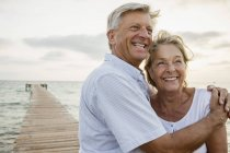 Senior couple embracing at the sea — Stock Photo