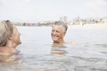 Senior couple swimming in Atlantic ocean — Stock Photo